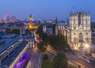 Westminster Abbey and the River Thames. The London Eye in the background. Credit: Visit Britain