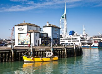 Boats floating in Camber Dock in Old Portsmouth, with the Spinnaker Tower in the distance. Credit: Visit Britain