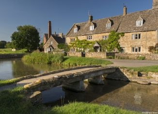 Traditional Cotswold stone cottages and stone footbridge in the Cotswolds village of Lower Slaughter. Credit: Visit Britain