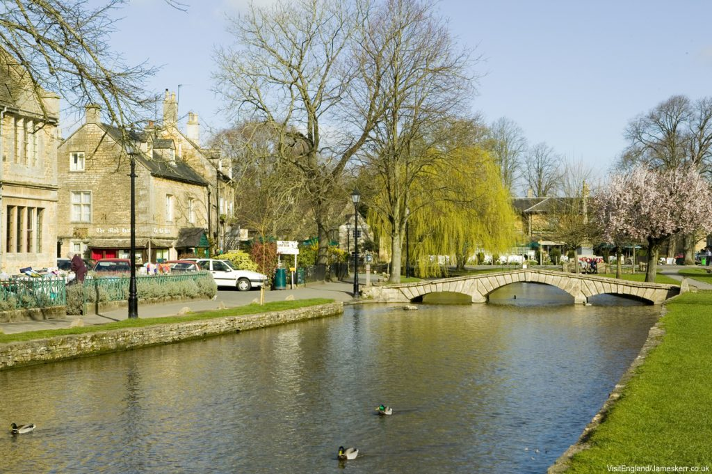 View across the river at Bourton on the Water. Credit: Visit Britain