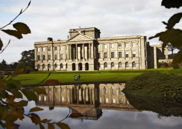 An autumnal view of the lake and south front of Lyme Park, Cheshire. The house was originally Elizabethan but was transformed in the Italianate style by architect Giacomo Leoni in the early eighteenth century.