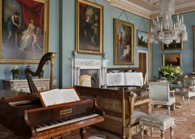 The Drawing Room at Attingham Park, Shropshire. The room was designed in the 1780s, but the blue colour scheme was introduced in the early nineteenth century. The piano is by Collard & Collard, 1836.