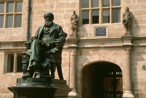 A statue of Charles Darwin stands outside the library