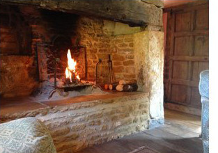 The cosy fireplace at the Secret Cottage in the Cotswolds