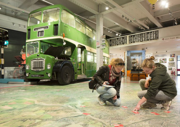Visitors in the M-Shed Bristol museum with vintage bus. Photo: VisitEngland/Iain Lewis