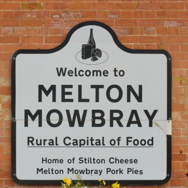 Station sign at Melton Mowbray makes it clear what the town is famous for! © Norman Miller