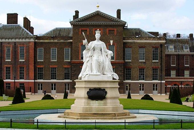 In front of the east front public entrance stands a statue of Queen Victoria, sculpted by her daughter Princess Louise.