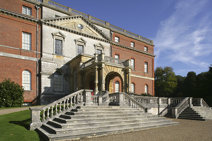 Entrance or west front with pedimented section, or porte-cochere, added in 1876, and staircase at Clandon Park, Guildford, Surrey, built around 1731 by Italian architect Giacomo Leoni.