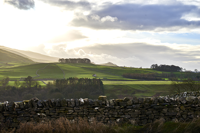 View across a drystone wall across the landscape at Grassington, Yorkshire.