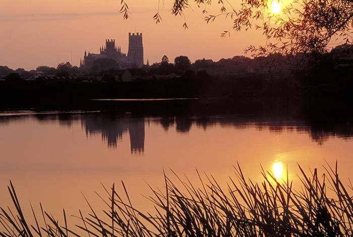 Ely Cathedral silhouetted at sunset. Credit: VisitBritain