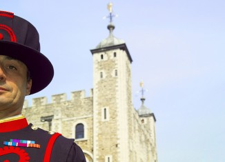 A Yeoman Warder or 'Beefeater', traditionally responsible for guarding the gates and royal prisoners at the Tower of London. Credit: VisitBritain