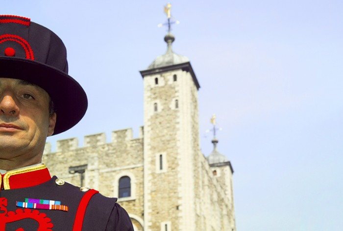 A Yeoman Warder, or Beefeater, traditionally responsible for guarding the gates and royal prisoners at the Tower of London. Credit: VisitBritain
