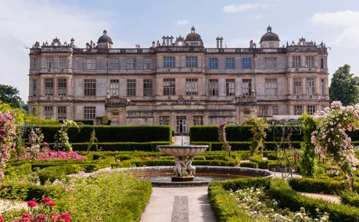 The formal gardens behind the main Elizabethan house of Longleat in Wiltshire. Credit: T.M.O.Travel/Alamy