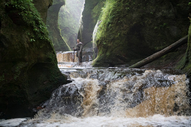 King Arthur: Legend of the Sword on location at The Devils Pulpit, Finnich Glen, Killearn, Scotland. © 2017 Warner Bros. Entertainment, Inc. All rights reserved