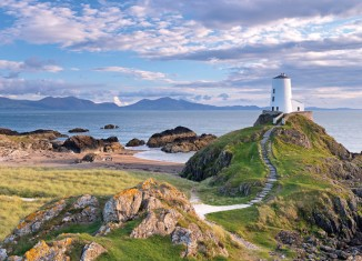 Twr Mawr lighthouse on Llanddwyn Island, Anglesey, North Wales. Credit: Adam Burton/Alamy