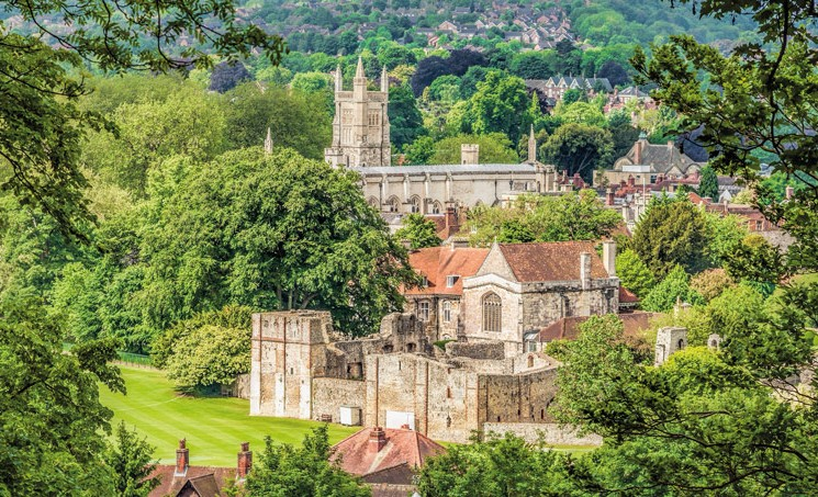 Distant view St. Cross in Winchester, Hampshire. Credit: travelbild/Alamy