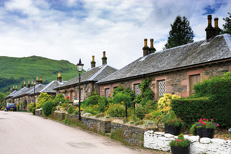 Old stone cottages in historic village of Luss in Argyll and Bute Scotland