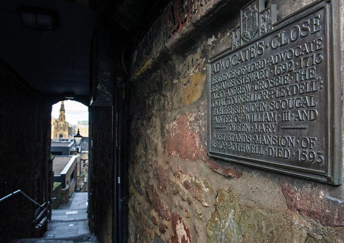 The bronze plaque at the entrance to Advocates Close on Edinburgh's historic Royal Mile. Credit: Ian Rutherford / Alamy