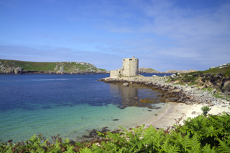 Cromwell's Castle in summer sunshine, Isle of Tresco, Isles of Scilly, United Kingdom